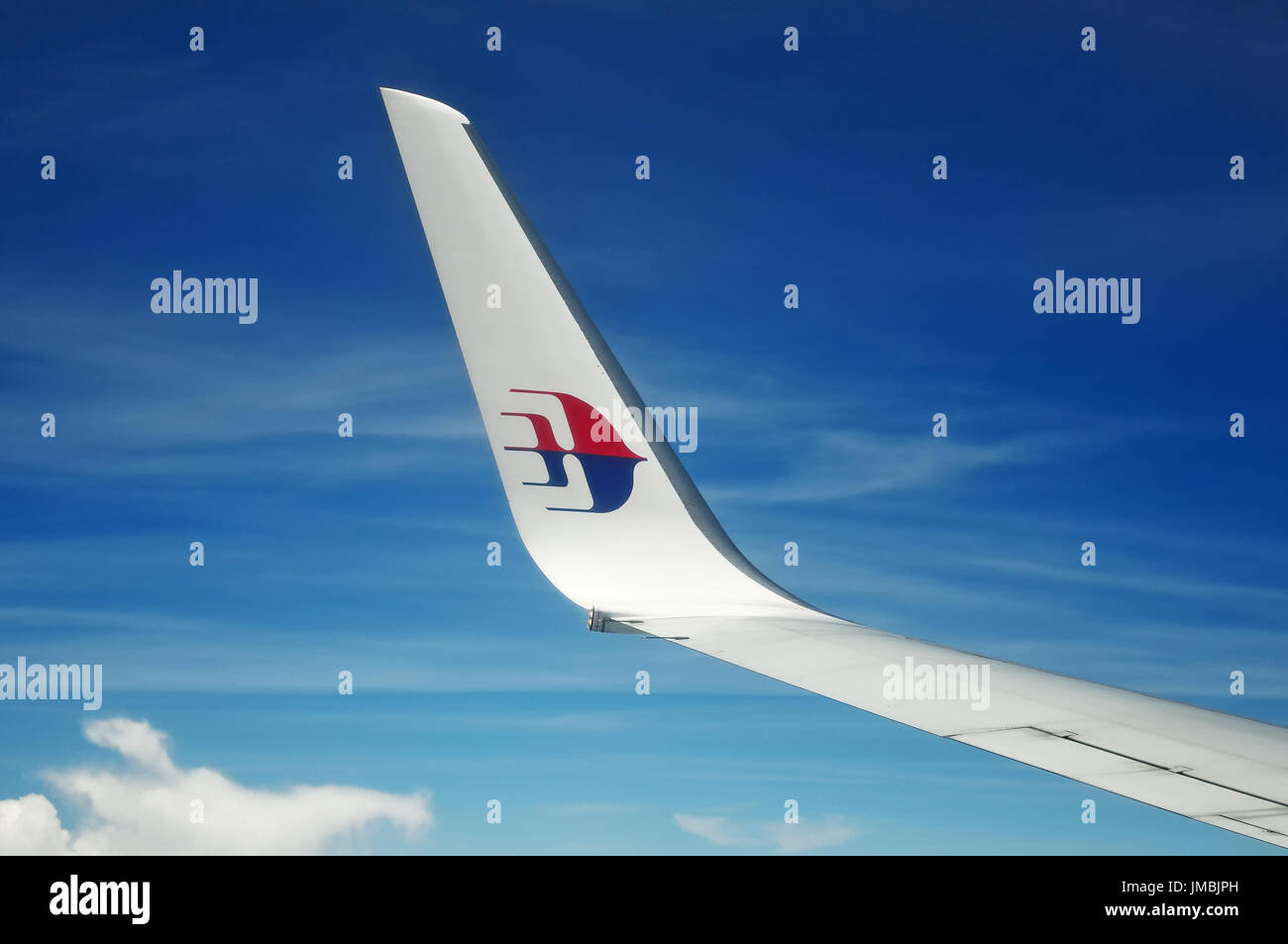 KUALA LUMPUR, MALAYSIA - MAY 09, 2015: Malaysia Airlines airplane wing with MAS logo on the sky. Malaysia Airlines behad is the flag carrier of Malays - Stock Image