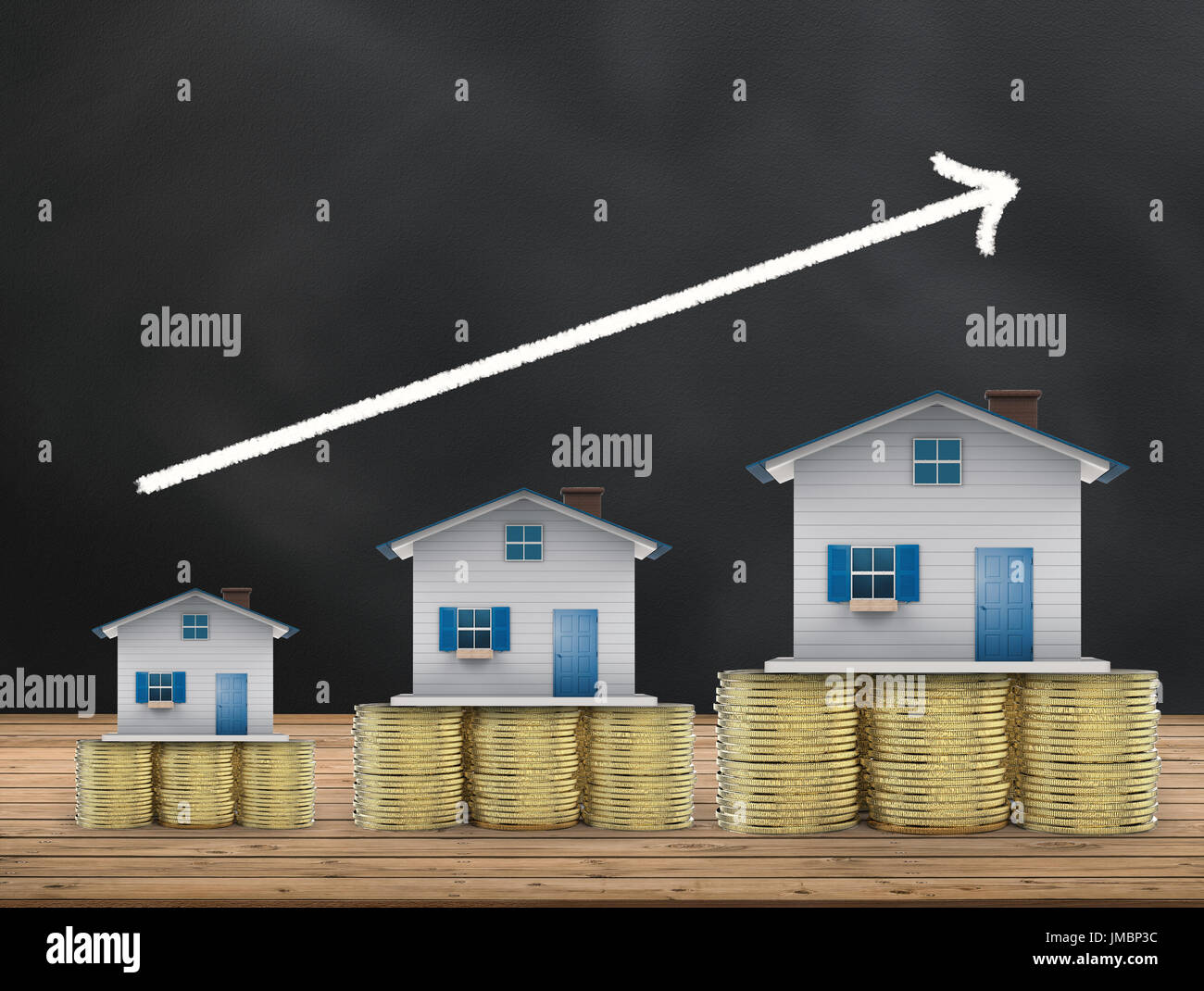 real estate investment concept with mock up houses and gold coins - Stock Image