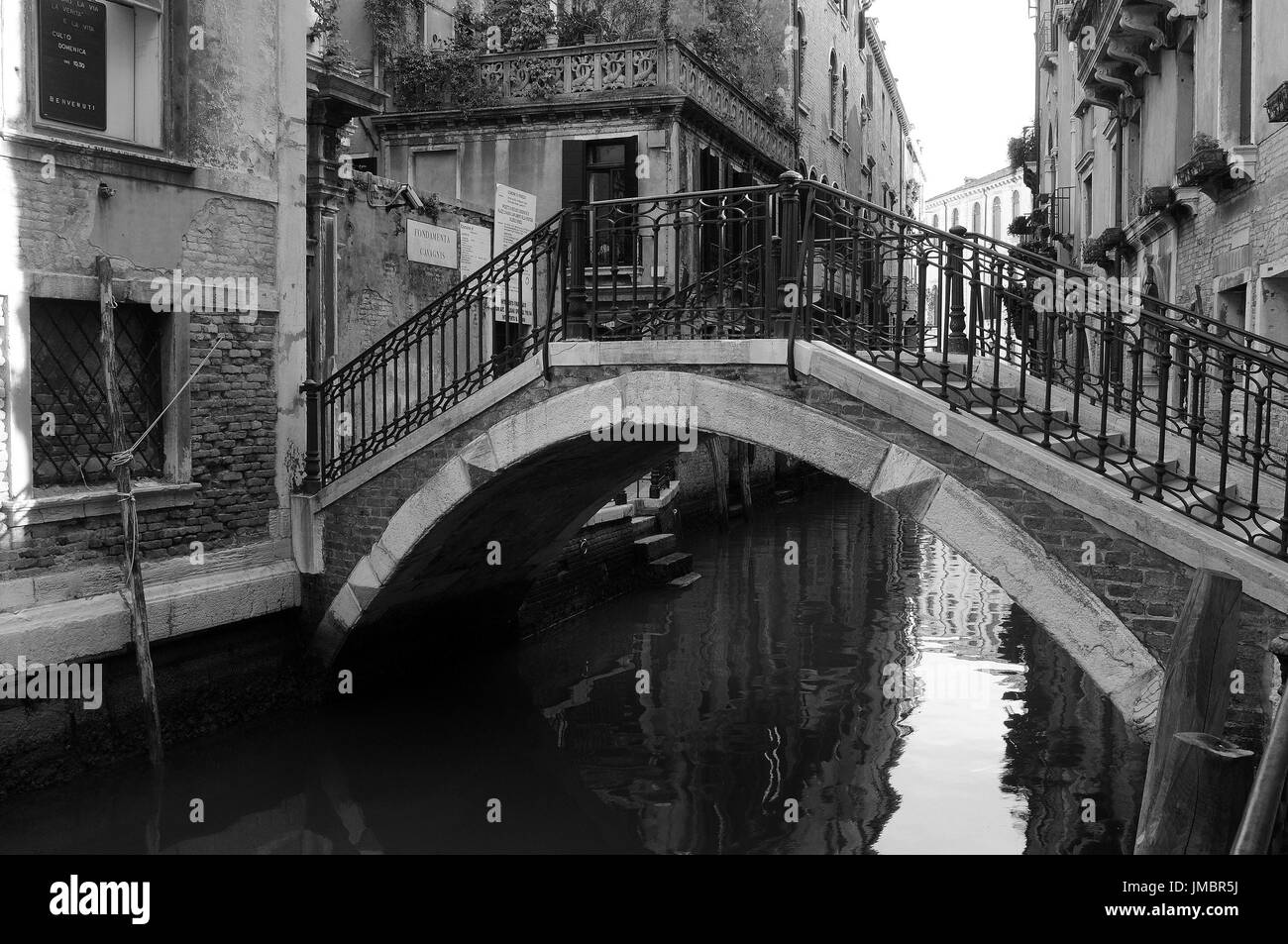 Bridge over canal, Venice. - Stock Image