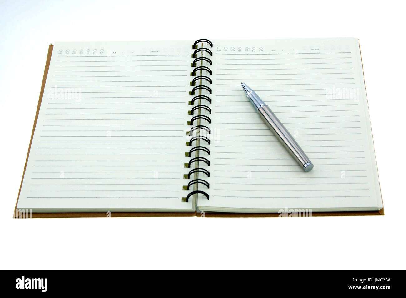 Open note book with empty pages with pen on white background Stock Photo