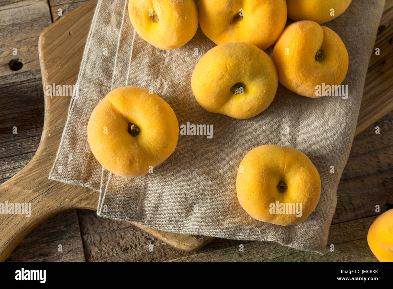 Raw Organic Yellow Donut Saturn Peaches Ready to Eat - Stock Image