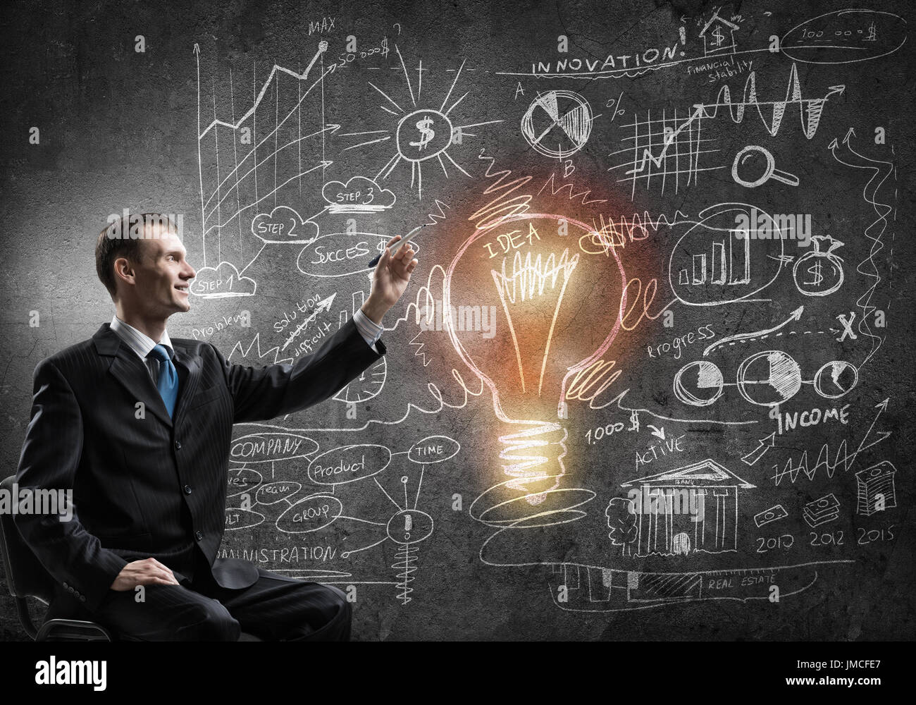 Businessman drawing business strategy Stock Photo