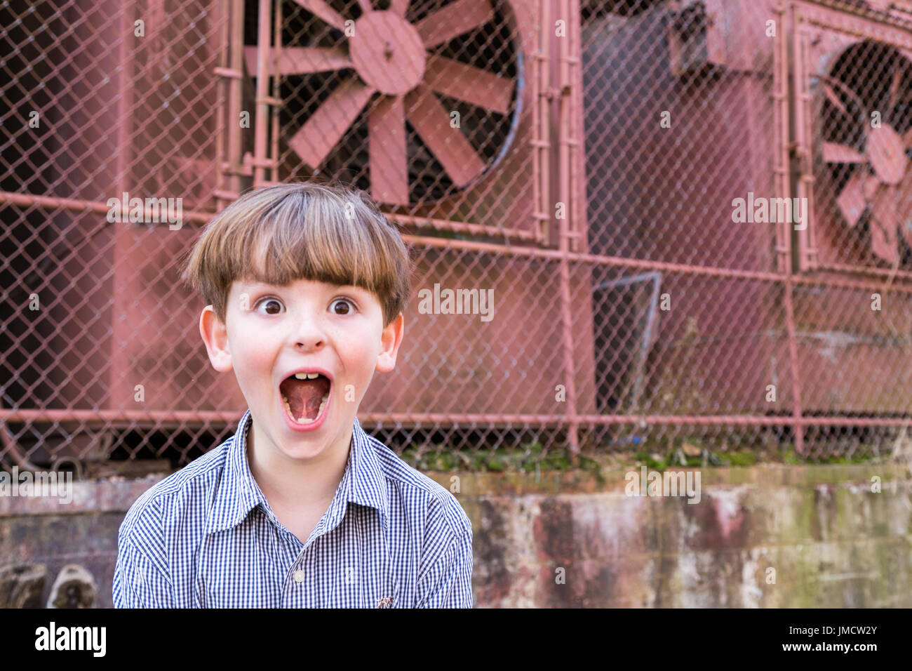 Silly little boy making funny face - Stock Image