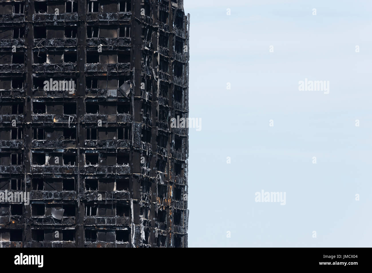 The charred remains of Grenfell Tower, Notting Hill, London, Britain. The 24 storey residential Tower block was engulfed in flames in the early hours  - Stock Image
