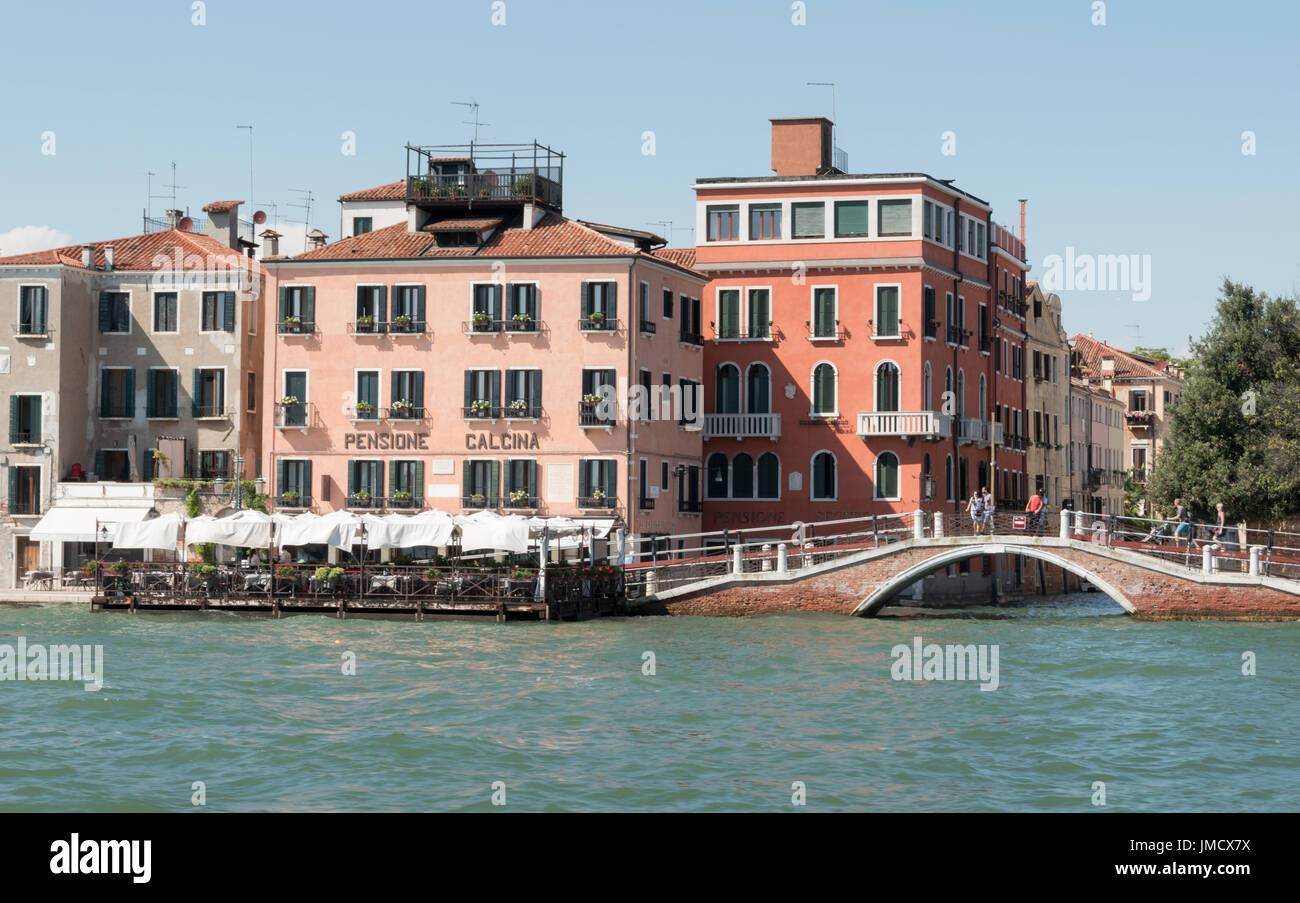 Pensione La Calcina, a small hotel on the Giudecca Canal viewed from a boat on the water - Stock Image