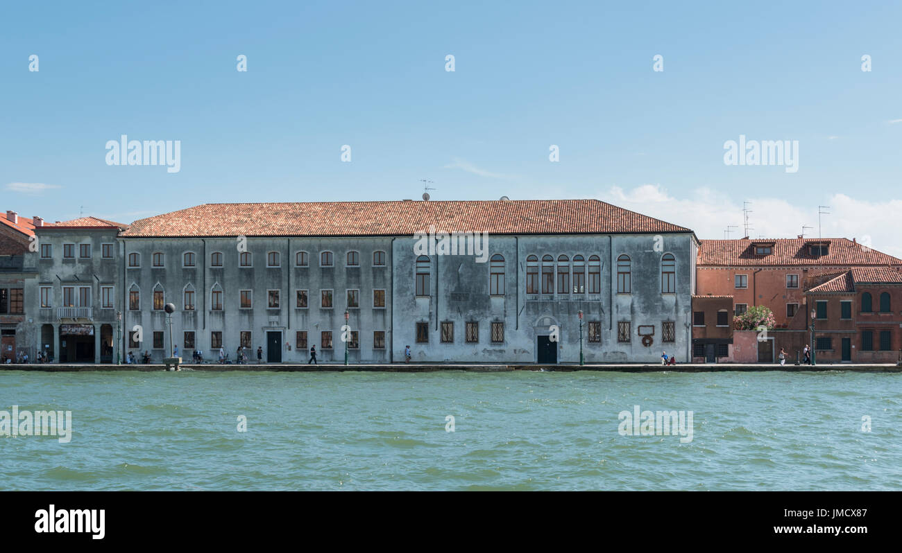 Austere looking building on the Giudecca Canal in Venice, Italy. - Stock Image