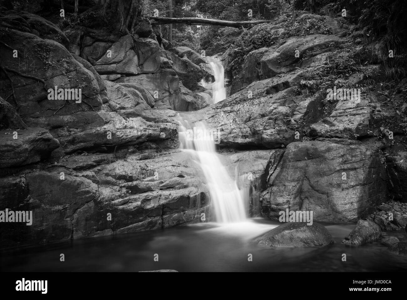 Black and white photograph of rainforest waterfall and riverside scenery taken in the national parks of Sarawak, Malaysia - Stock Image