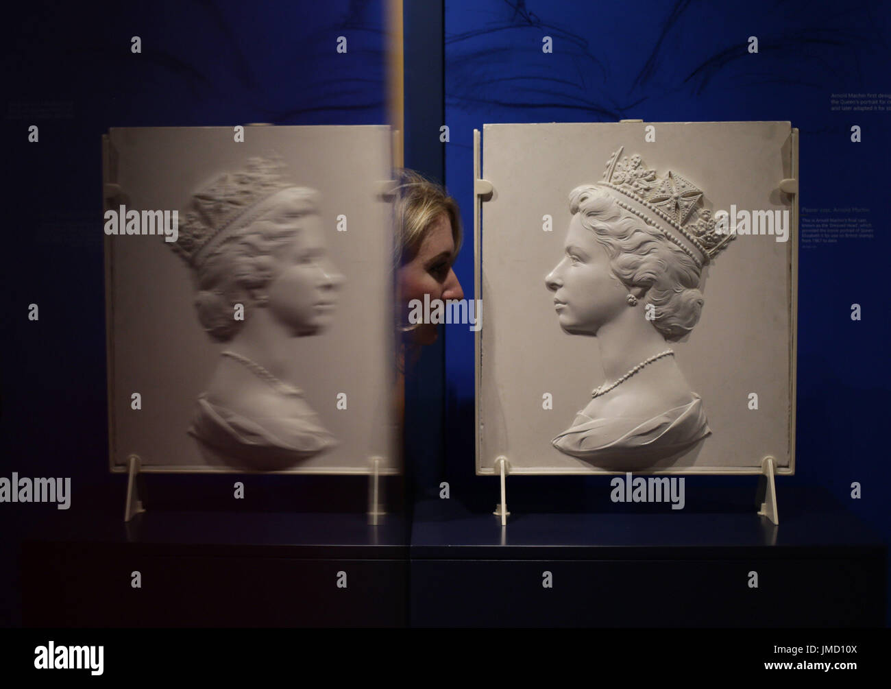 Embargoed to 0001 Friday July 28 A final plaster cast known as the 'Dressed Head', by Arnold Machin, of Queen Elizabeth II, which provided the portrait for use on British stamps from 1967 to date, on display during a preview of the Postal Museum in London. - Stock Image