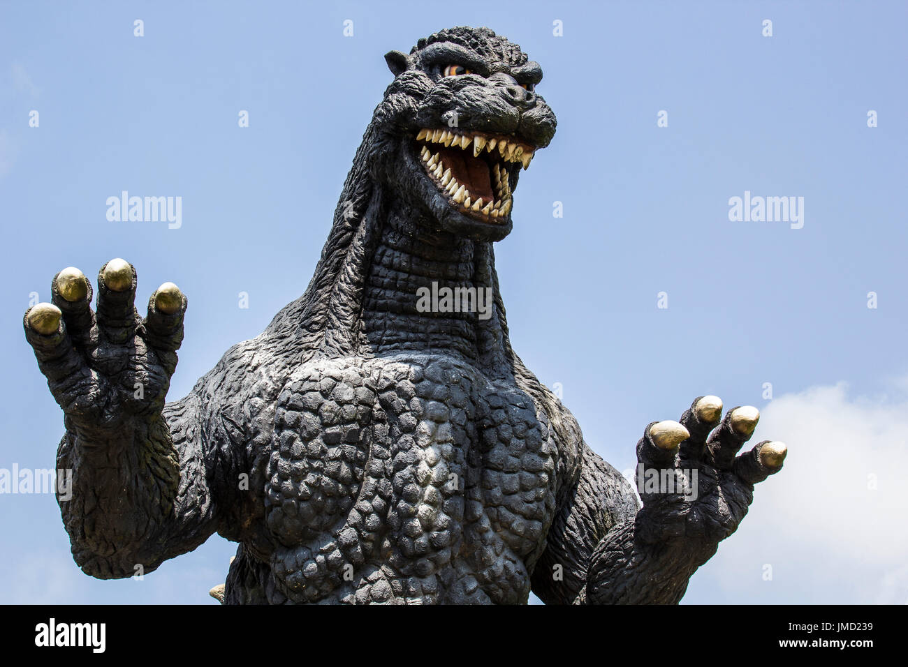Godzilla has starred in countless films, both cheesy and exciting.  Unlike in the movies, when people were fleeing Godzilla in panic, on the contrary, - Stock Image