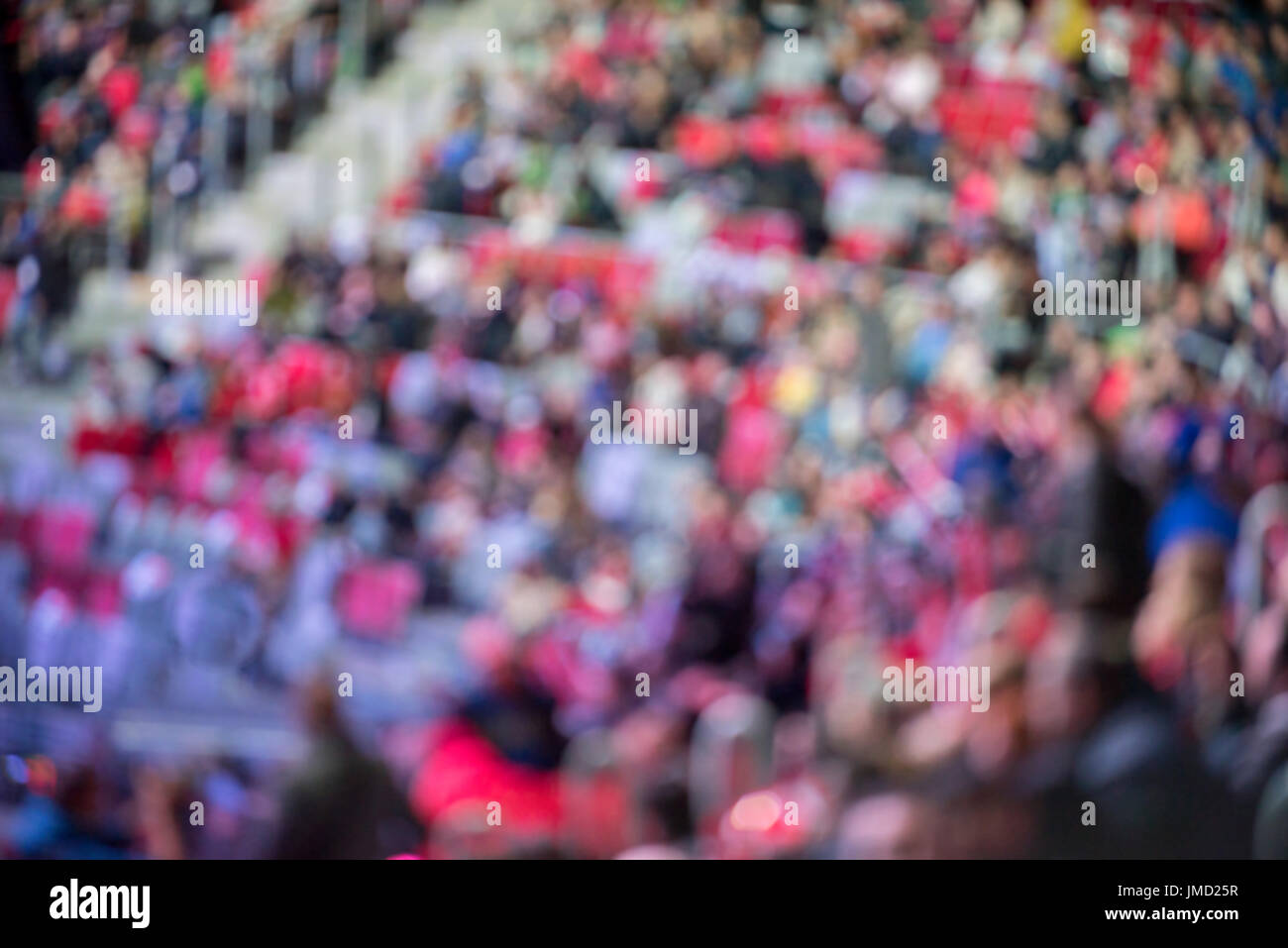 Blurred crowd of spectators on a stadium tribune - Stock Image