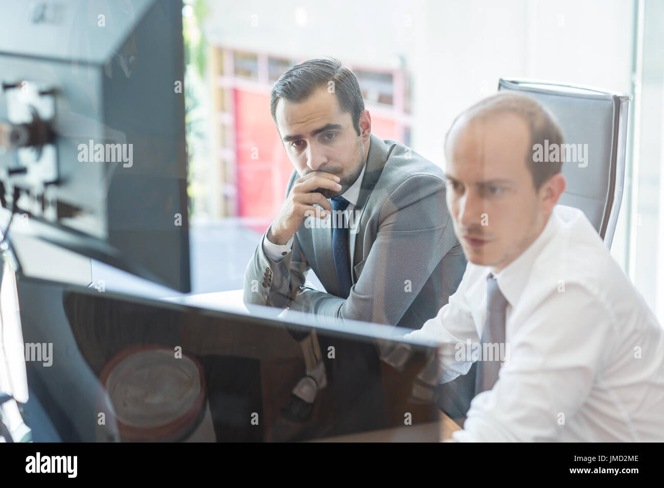 Business team analyzing data at business meeting. - Stock Image