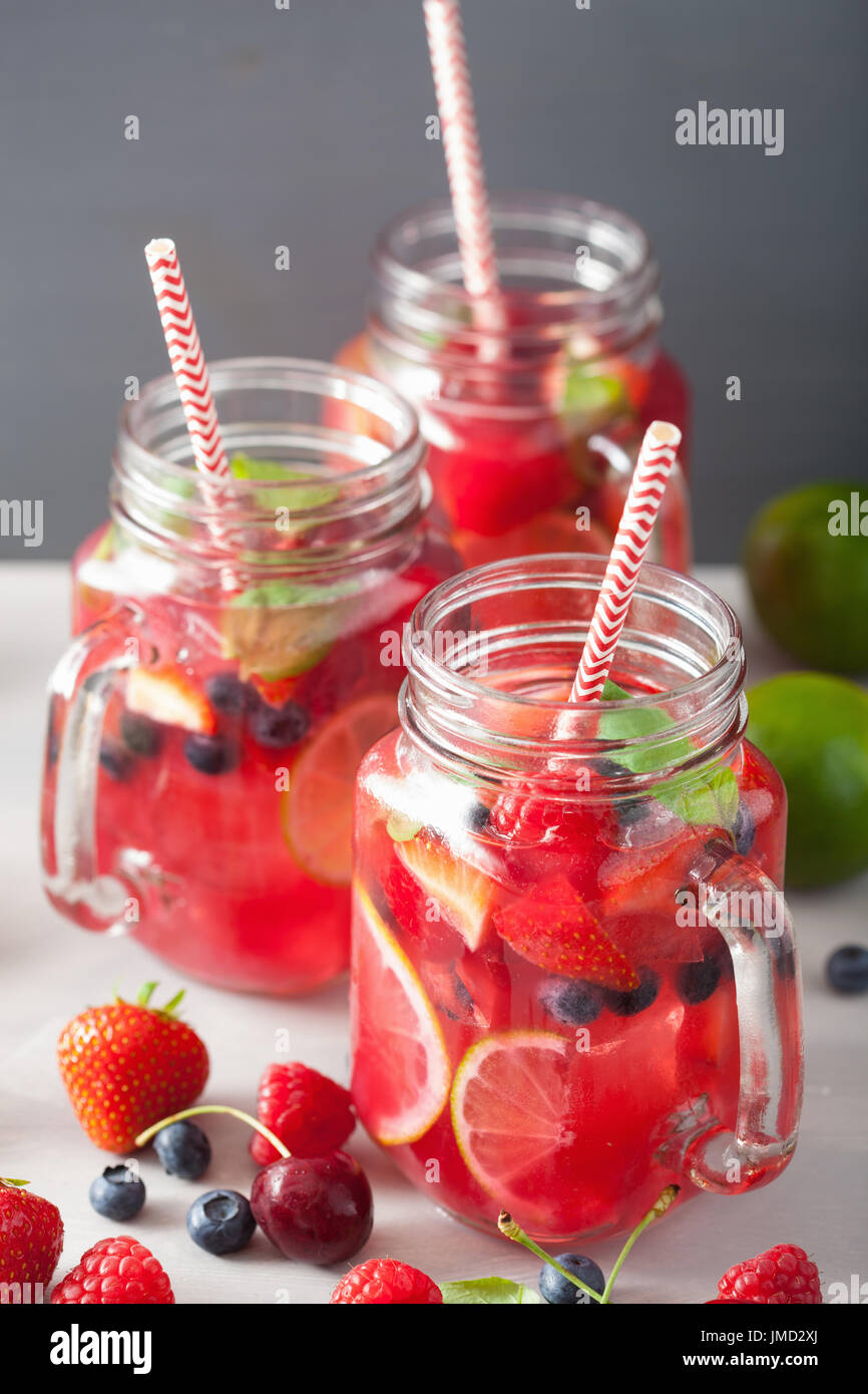 summer berry lemonade with lime and mint in mason jar Stock Photo