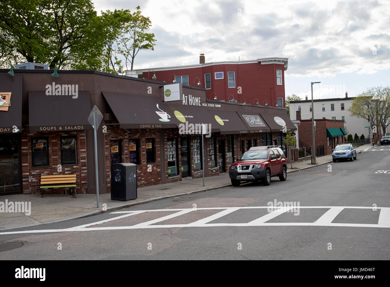 small strip mall corner shops on savin hill avenue Boston USA - Stock Image