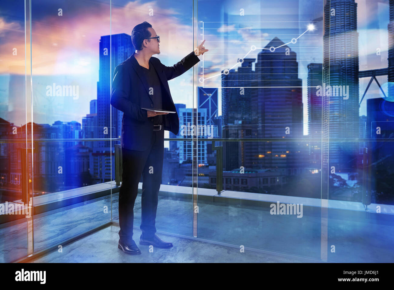 Businessman using digital table pad with virtual screen graph statistical analysis ,Business success concept. - Stock Image