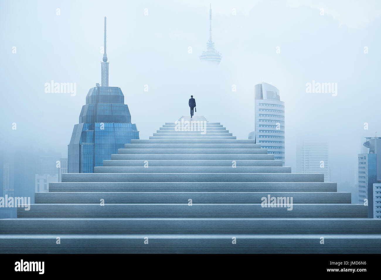 Ambitions concept with businessman climbing stairs - Stock Image