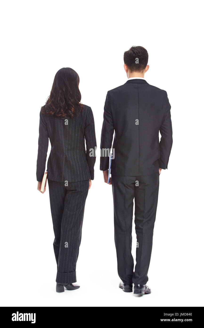 young asian business man and woman walking, rear view, isolated on white background. - Stock Image