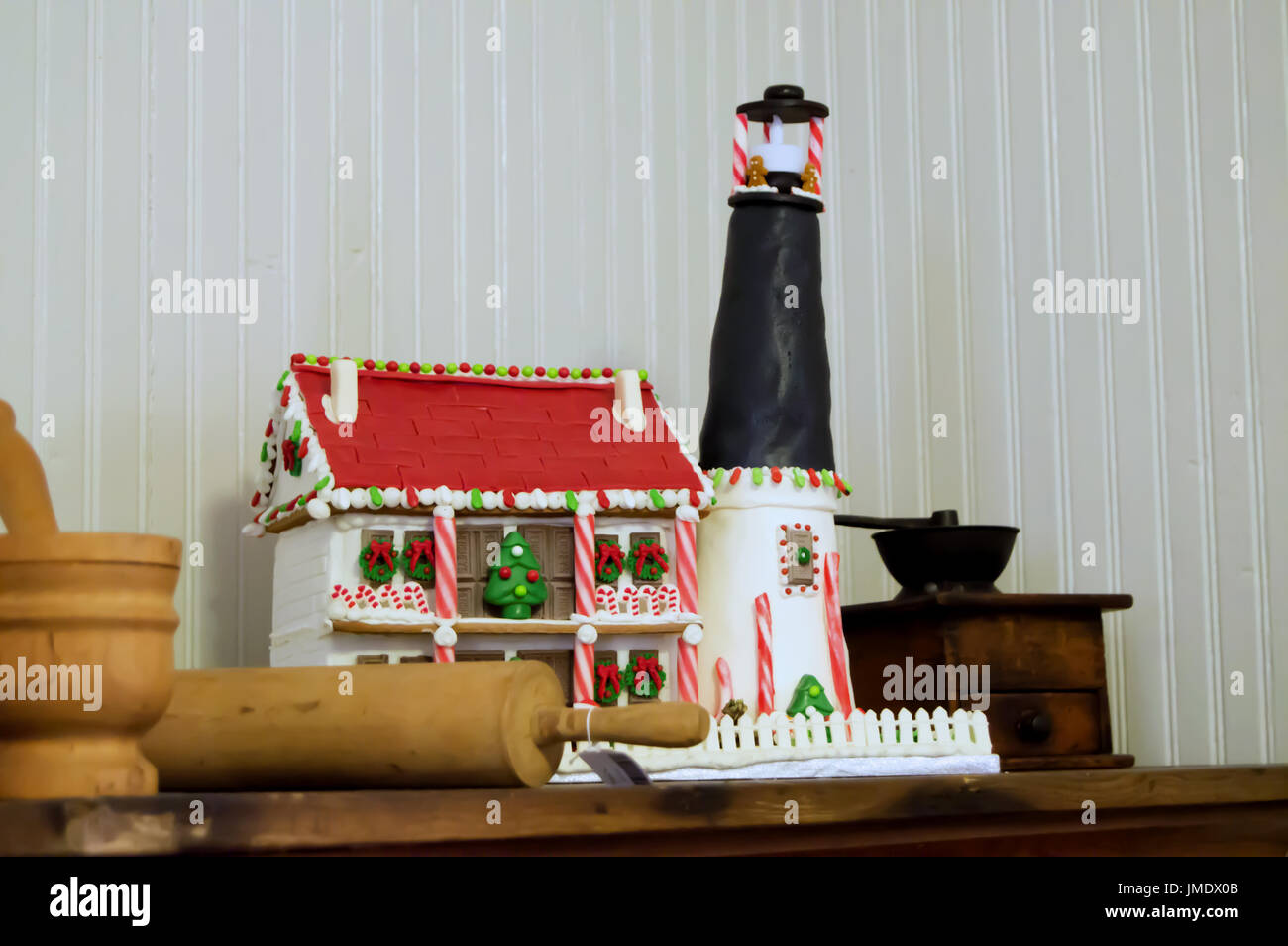 A Model Of The Pensacola Lighthouse In Gingerbread And Fondue House