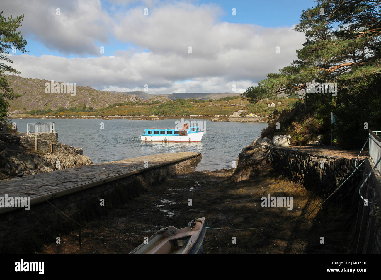 Passenger ferry leaving Garnish Island in Bantry Bay, West Cork, Ireland. - Stock Image