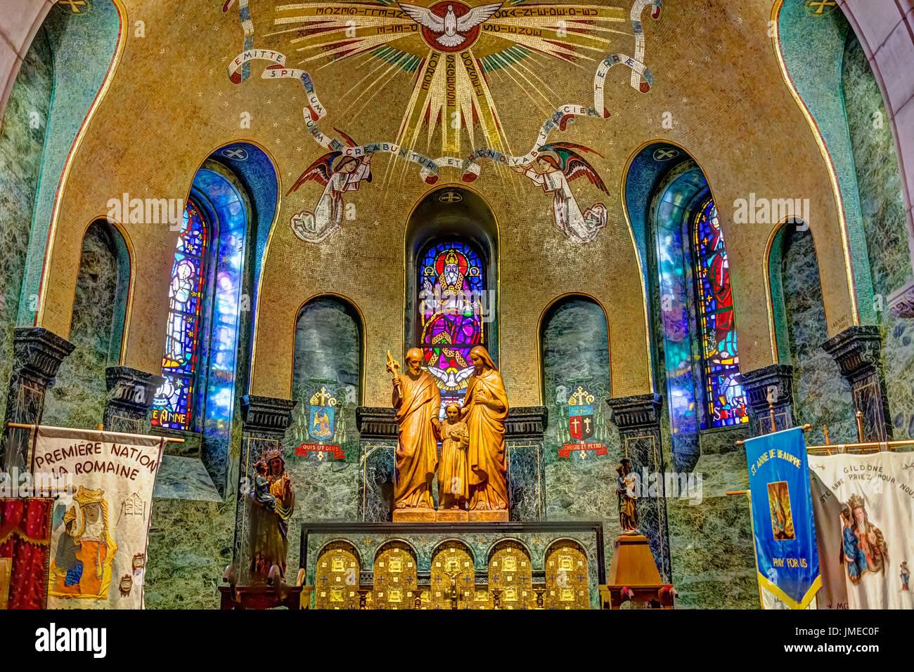 Sainte-Anne-de-Beaupre, Canada - June 2, 2017: Inside Basilica of Sainte Anne de Beaupre with statues and signs Stock Photo