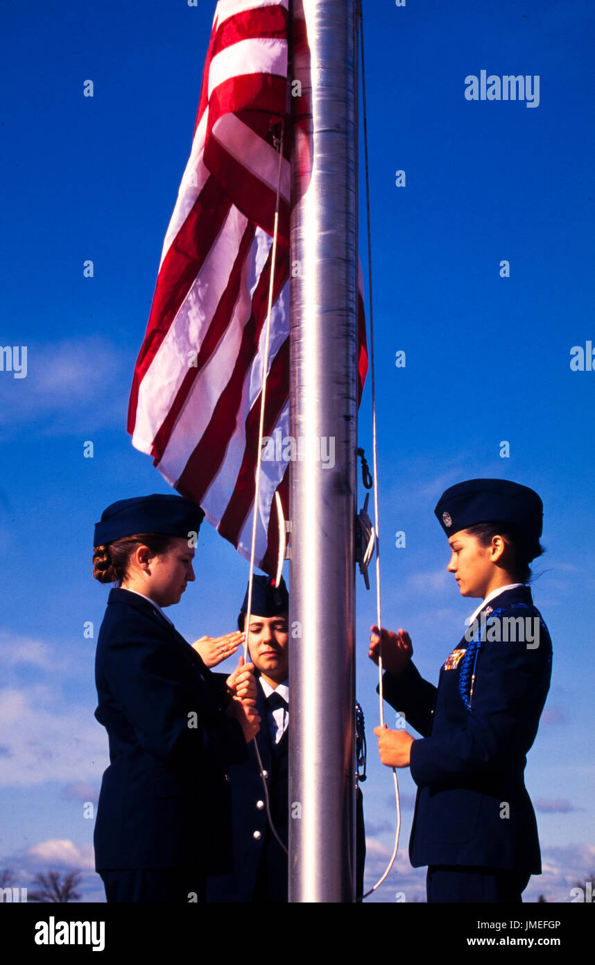 US flag raising ceremony performed by US Air Force ROTC - reserve officer training corps - high school cadets in uniform outside their high school - Stock Image