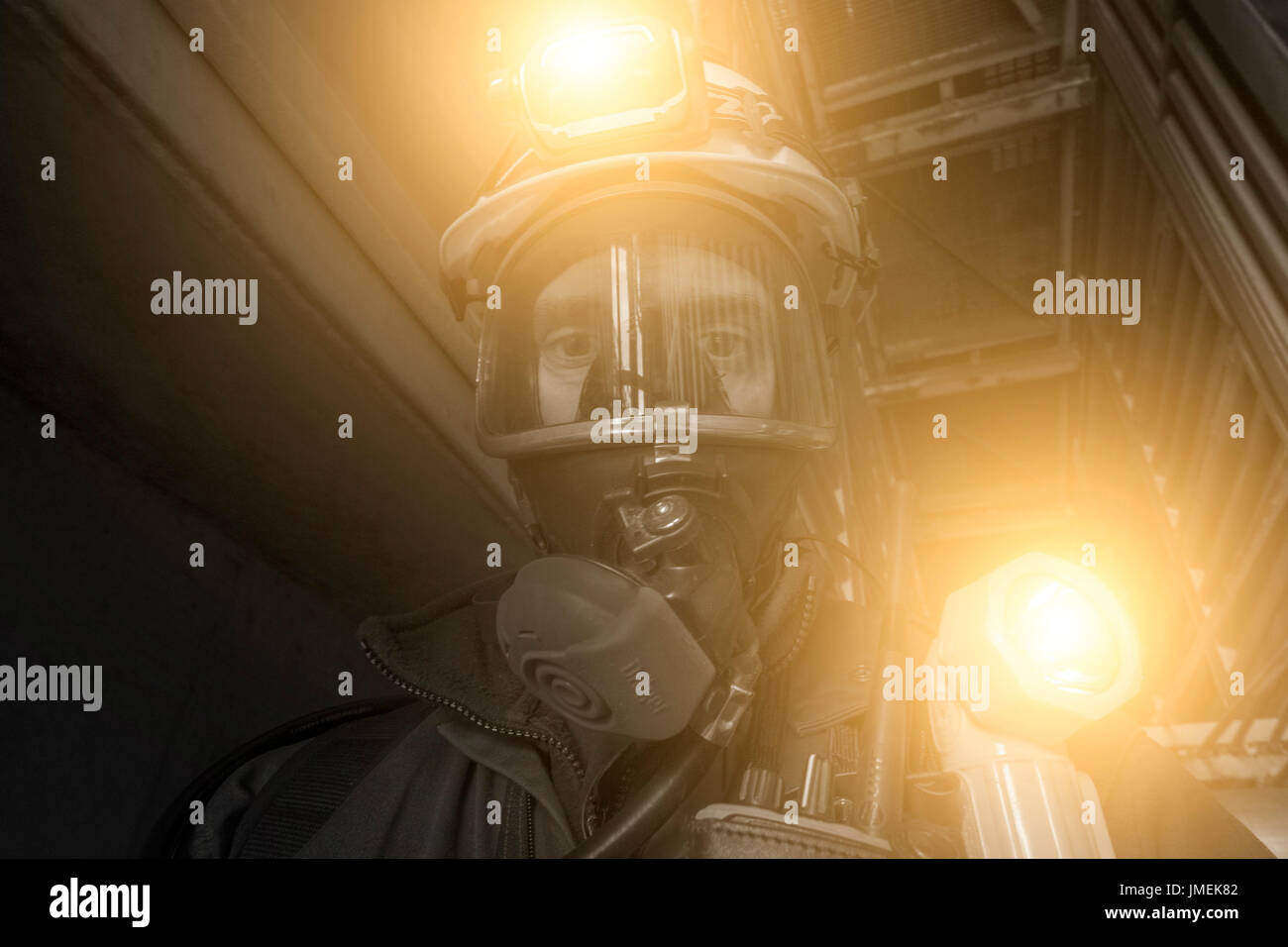 An edited stylised image of a North sea oil and gas worker, wearing full BA breathing apparatus. credit: LEE RAMSDEN / ALAMY - Stock Image