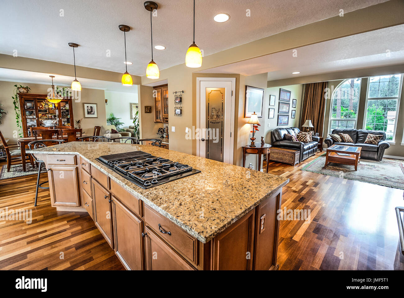 Spacious Luxury Home With Large Granite Top Center Island Kitchen And Open  Floor Plan And Great Room With Large Wall Of Windows