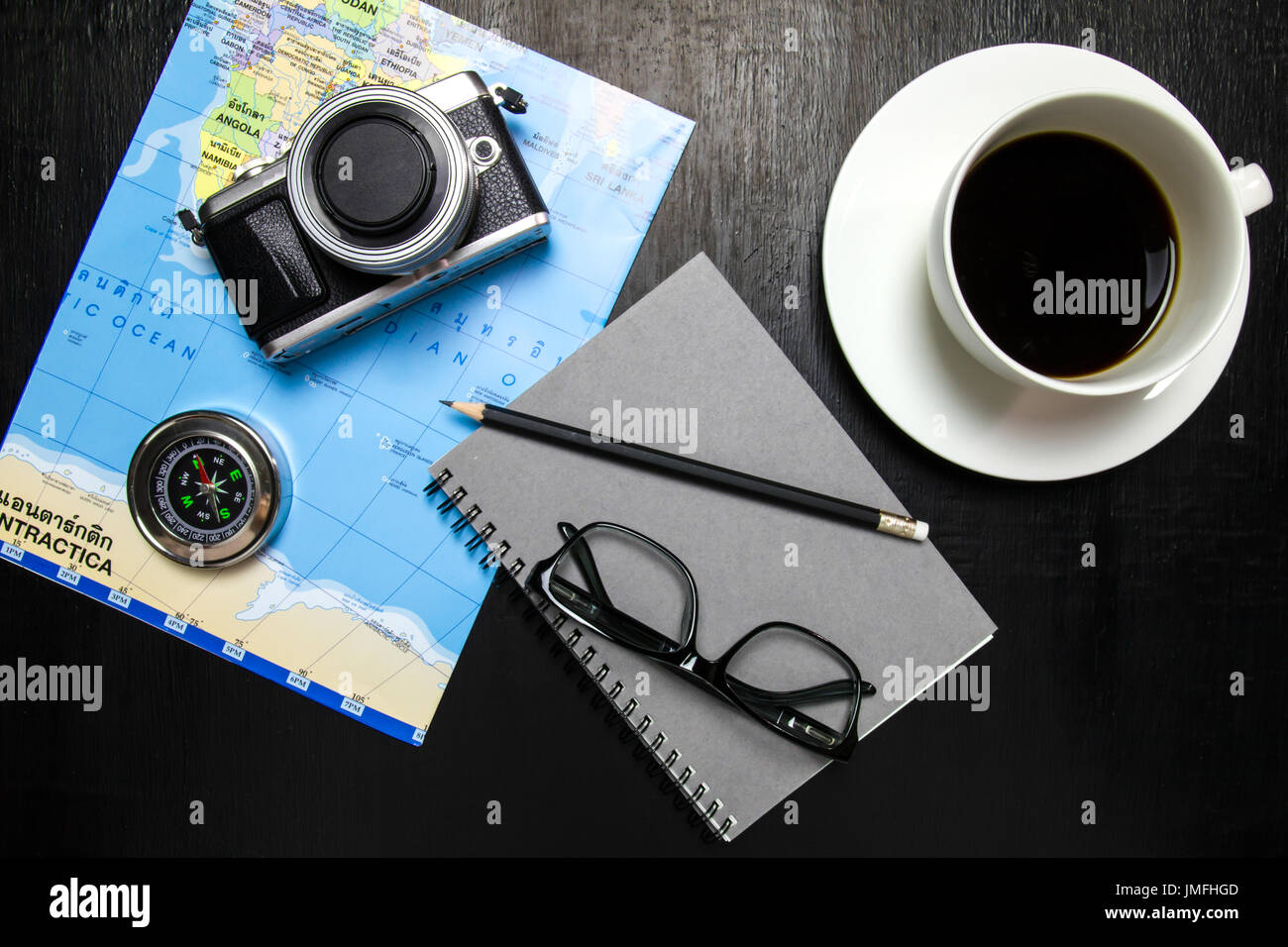 Top view of office desk workspace with coffee cup camera world map top view of office desk workspace with coffee cup camera world map compassnotebookpencil glasses on wooden background gumiabroncs Image collections
