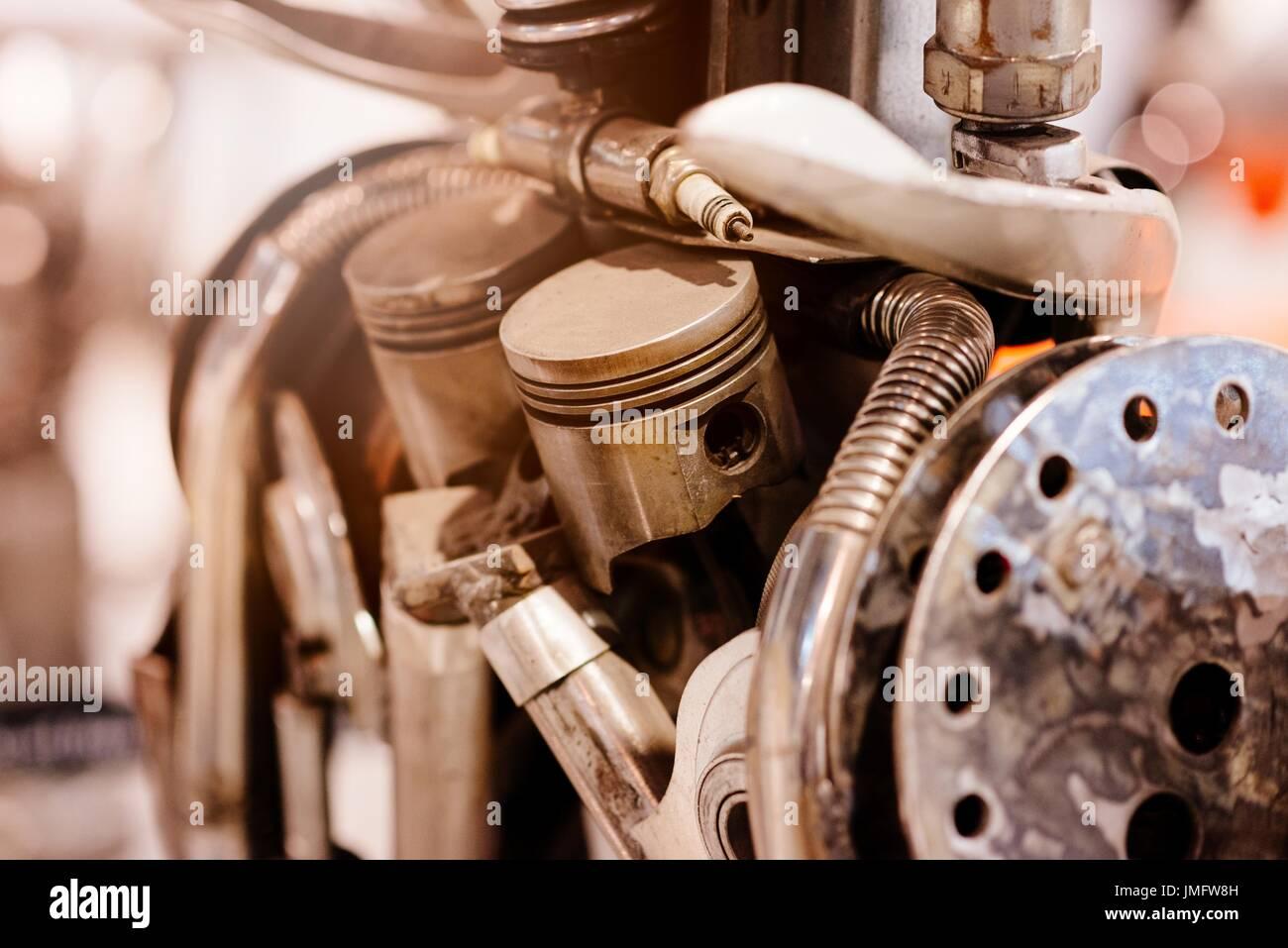Old metal automobile engine parts. Pistons, spark plug etc Stock ...