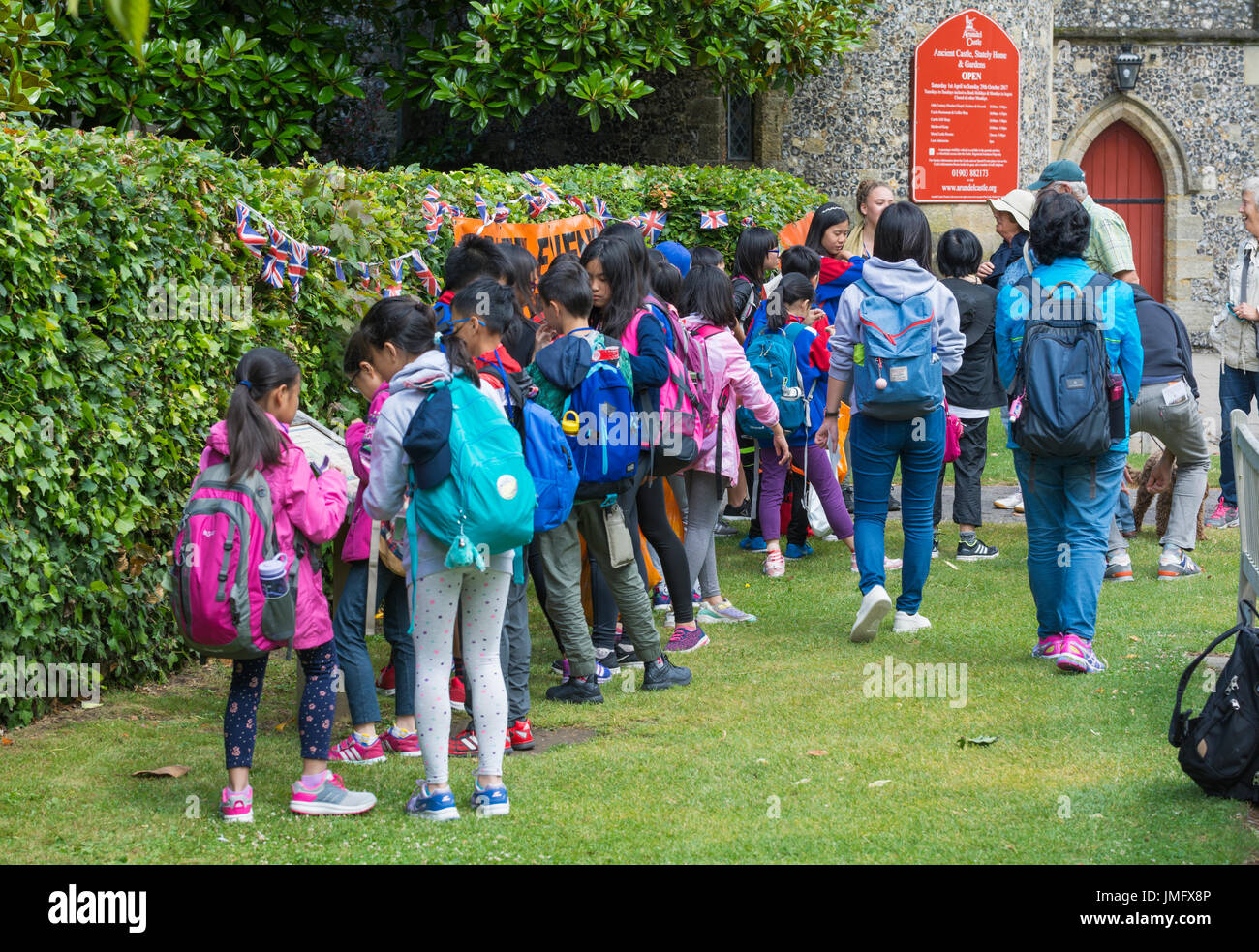 Group of young Japanese school children on a trip to England, UK, visiting a castle. Young tourists. - Stock Image
