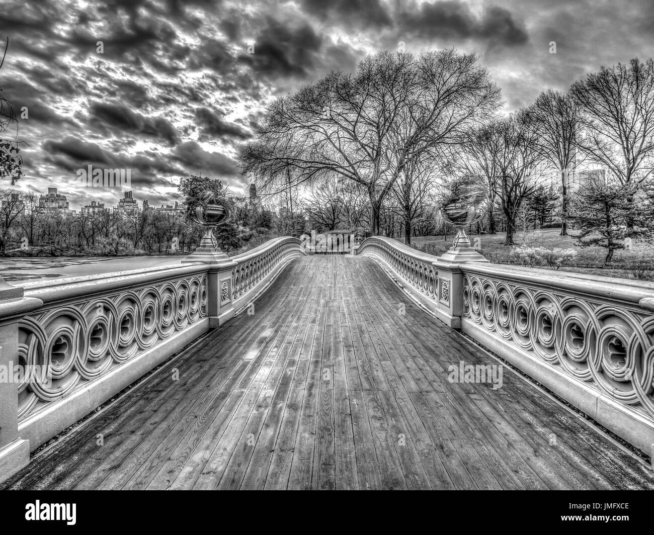 The Bow Bridge  is a cast iron bridge located in Central Park, New York City, crossing over The Lake - Stock Image
