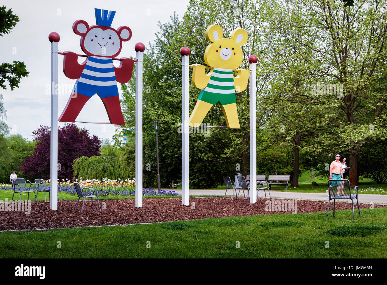 Berlin,Marzahn. Gardens of the World botanic garden,Gärten der Welt, amusing swings, Teddy bear cut-outs in Striped costumes for swinging - Stock Image