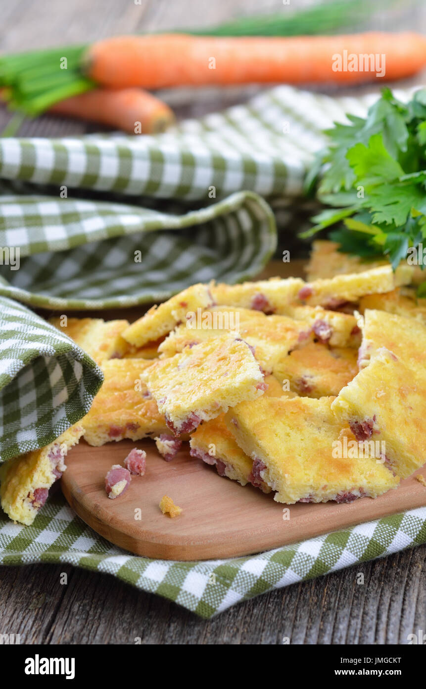 Austrian and German soup add-ins, so called 'Schoeberl', made of baked eggs and butter (salted biscuit) with ham or bacon, mostly served in a broth - Stock Image