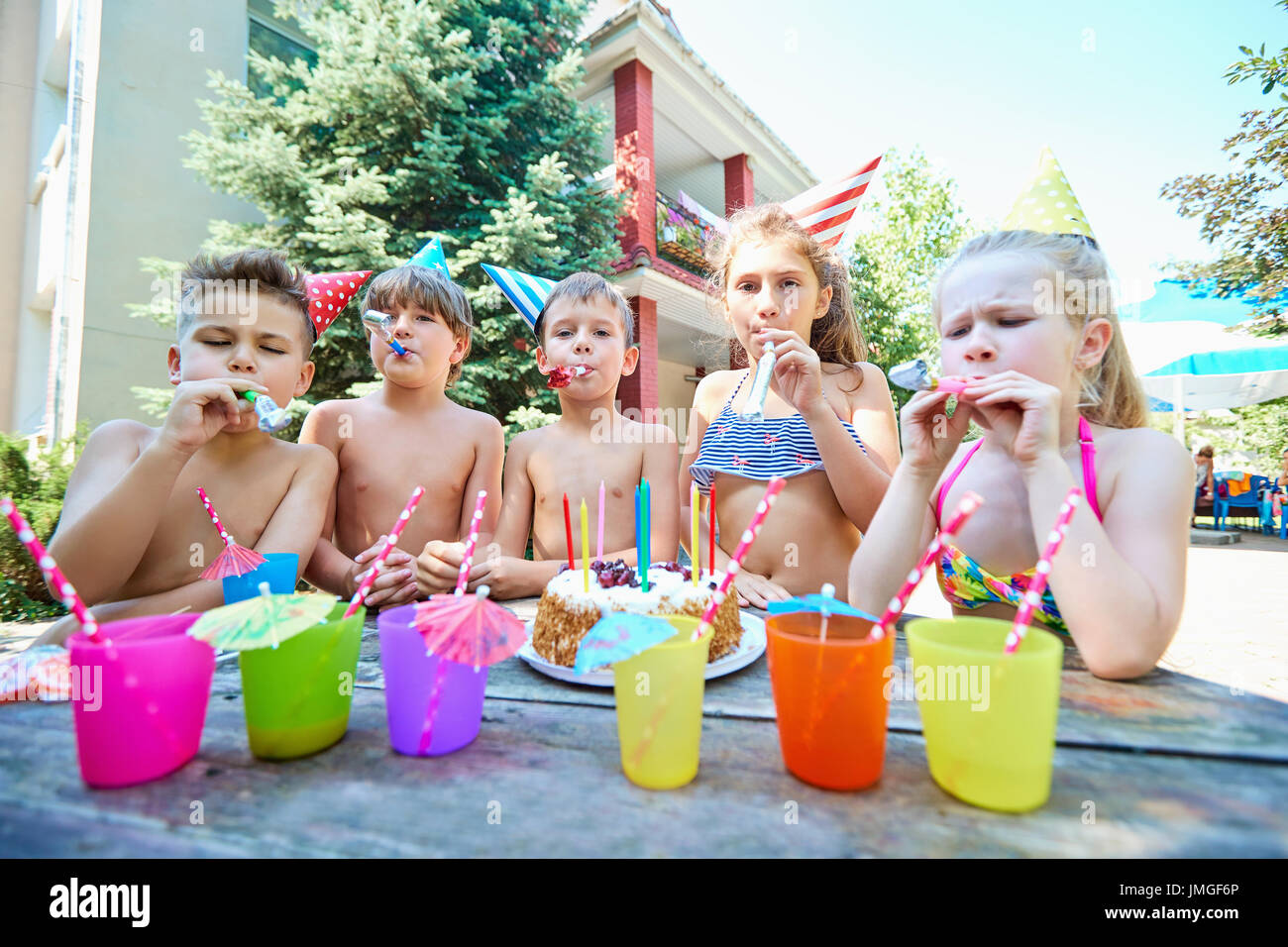 Birthday with children in hats in the summer - Stock Image