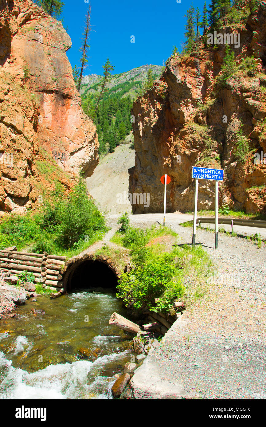Red Gates pass. Altai mountains. River in the red rocks. - Stock Image
