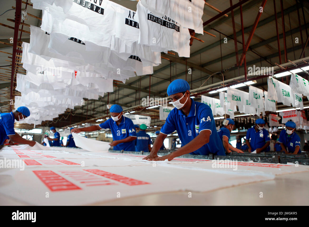 Workers in a printing section of a ready-made garment