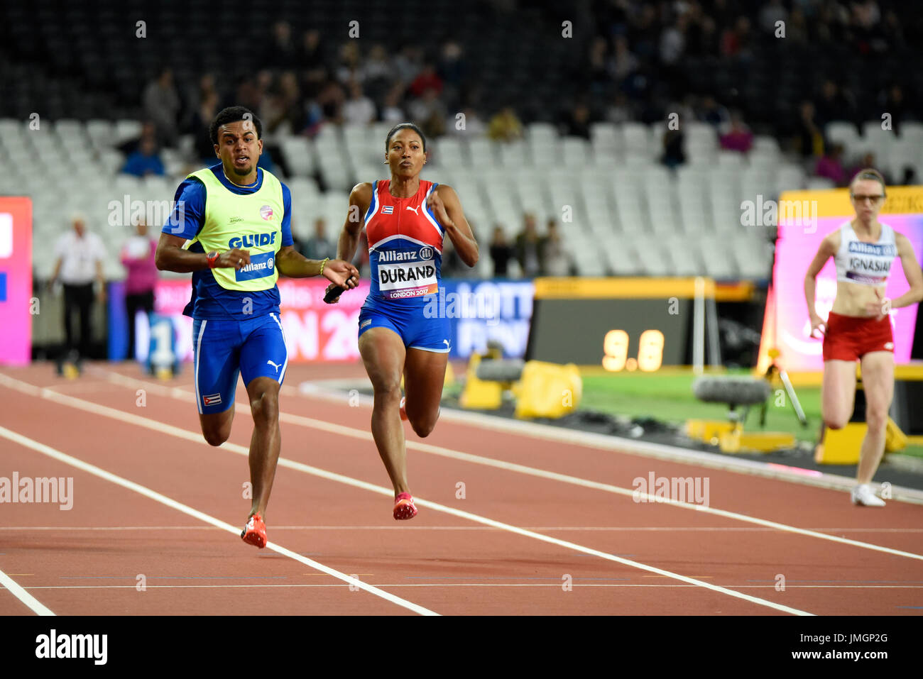 Omara Durand winning gold in the 100m T12 at the World Para Athletics Championships in the London Stadium. Guide Yuniol KINDELAN. Space for copy - Stock Image