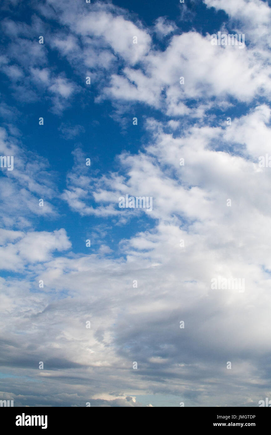 Blue sky with gray and white clouds. cumulonimbus. background, nature. - Stock Image