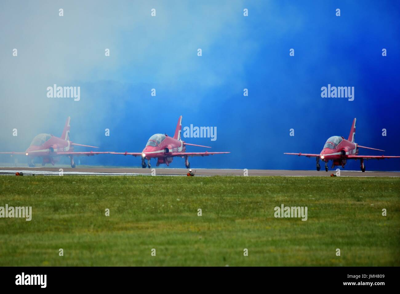 Red Arrows performing at the 2017 Royal International Air Tattoo held annually at RAF Fairford in Fairford, Gloucestershire, UK - Stock Image