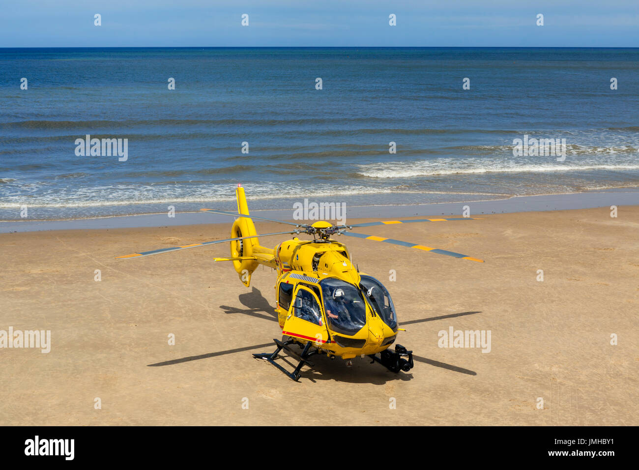 East Anglia Air Ambulance helicopter on the beach in Cromer, Norfolk, England, UK - Stock Image