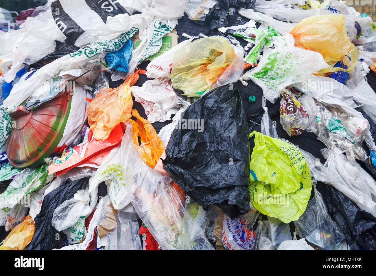 Plastic bags UK. Plastic bags environment UK. Plastic shopping bags. Plastic pollution UK. - Stock Image