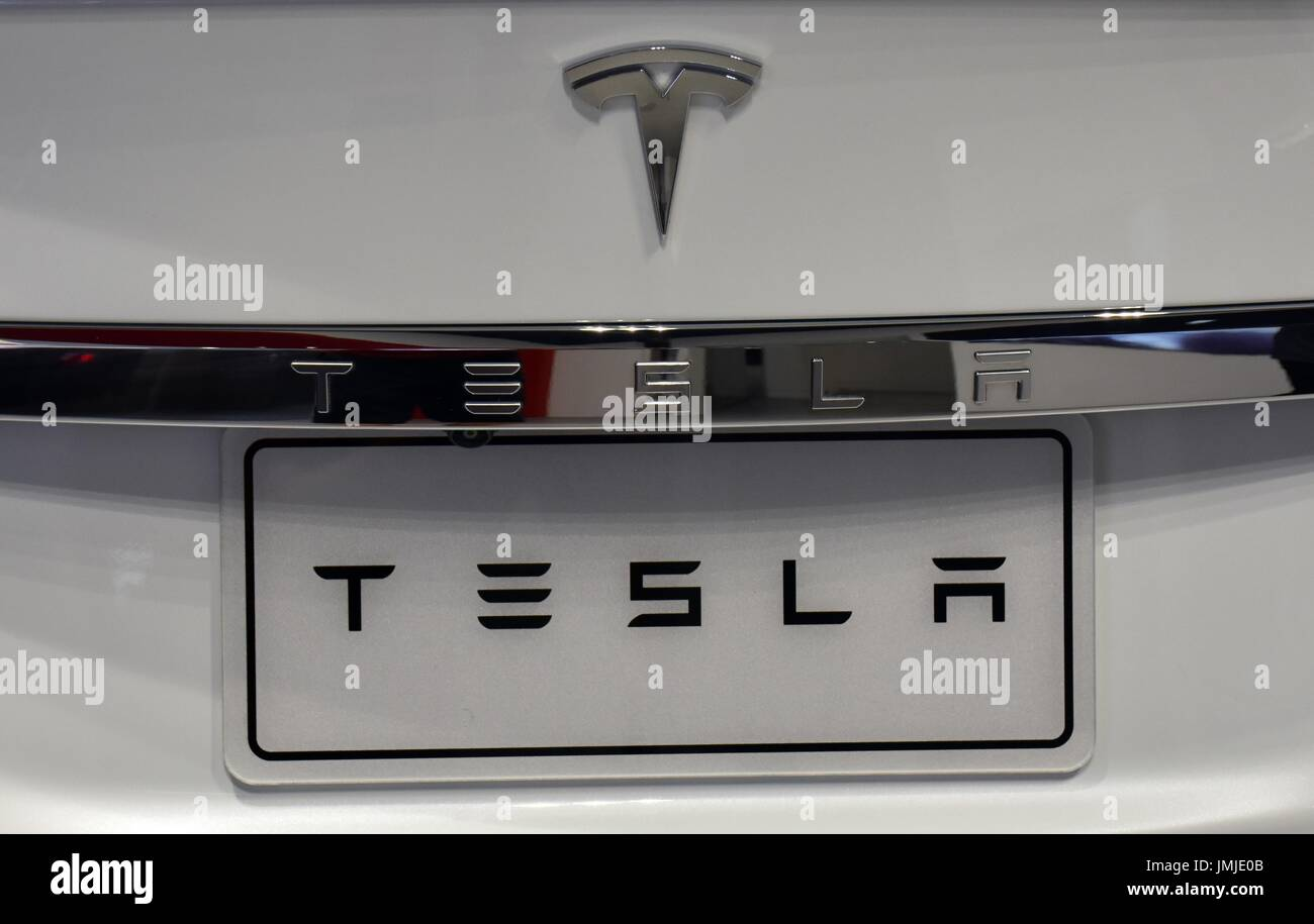 A Close up view of the plates and symbol on a white Model S Tesla 2017 on show room floor, Taipei, Taiwan. - Stock Image