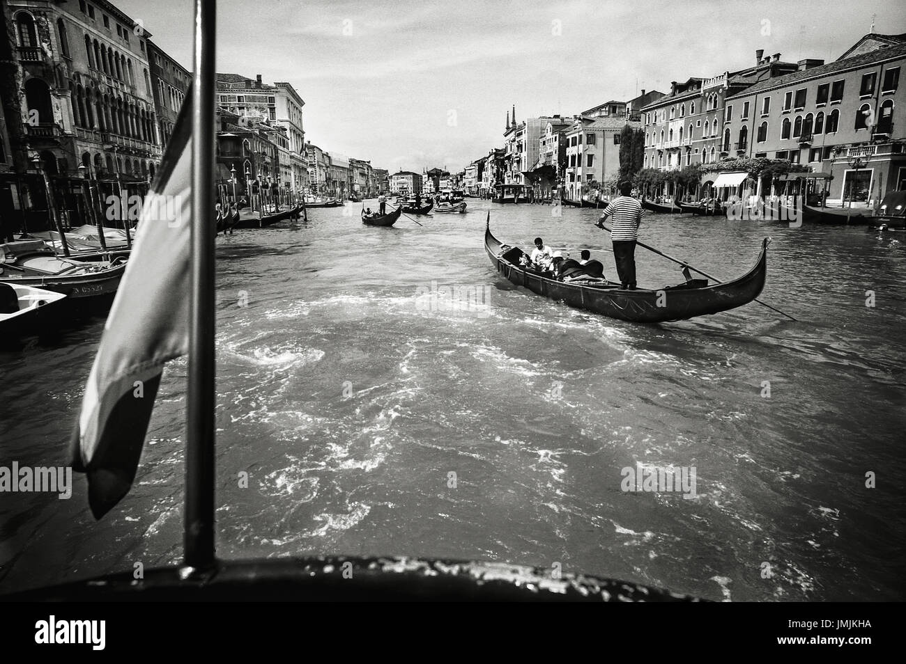 Image of the Grand Canal from a 'Vaporetto', a boat that is used quite in the same way as an urban bus in - Stock Image