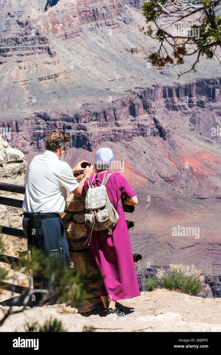 A couple of Amish tourists admire the beauty and take pictures of them,   Arizona, USA - Stock Image