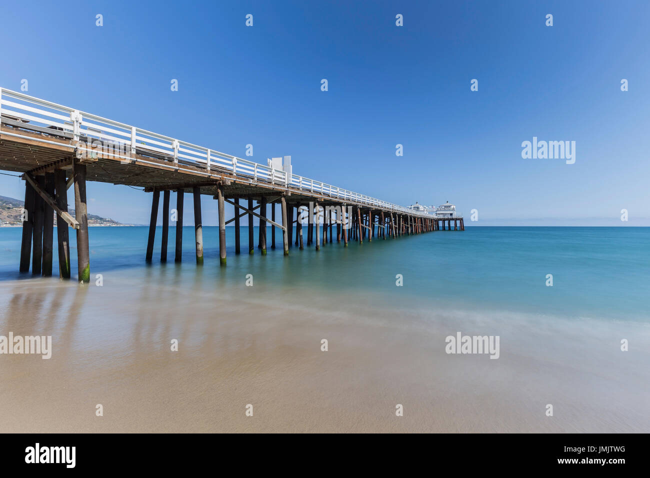 Malibu Pier beach with motion blur water near Los Angeles in California. - Stock Image