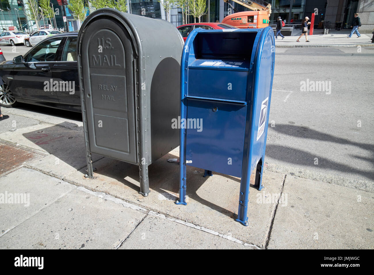 us postal service blue mailbox dropbox and grey relay mail box on sidewalk Boston USA - Stock Image