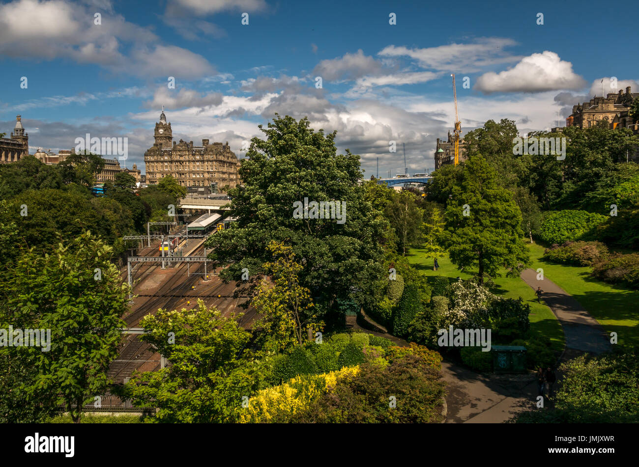 View of railway train lines into Waverley Station, Princes Street Gardens and landmark Rocco Forte Balmoral Hotel, Edinburgh, Scotland, UK - Stock Image