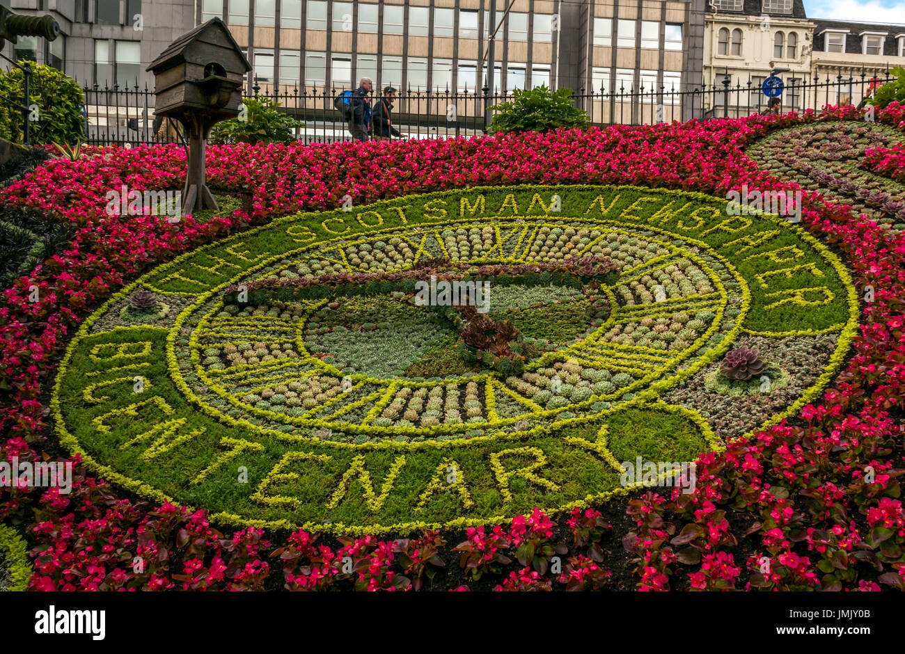 Edinburgh's city centre floral clock, oldest working clock in the world recreated each year, in 2017 commemorating bicentennial of Scotsman newspaper - Stock Image