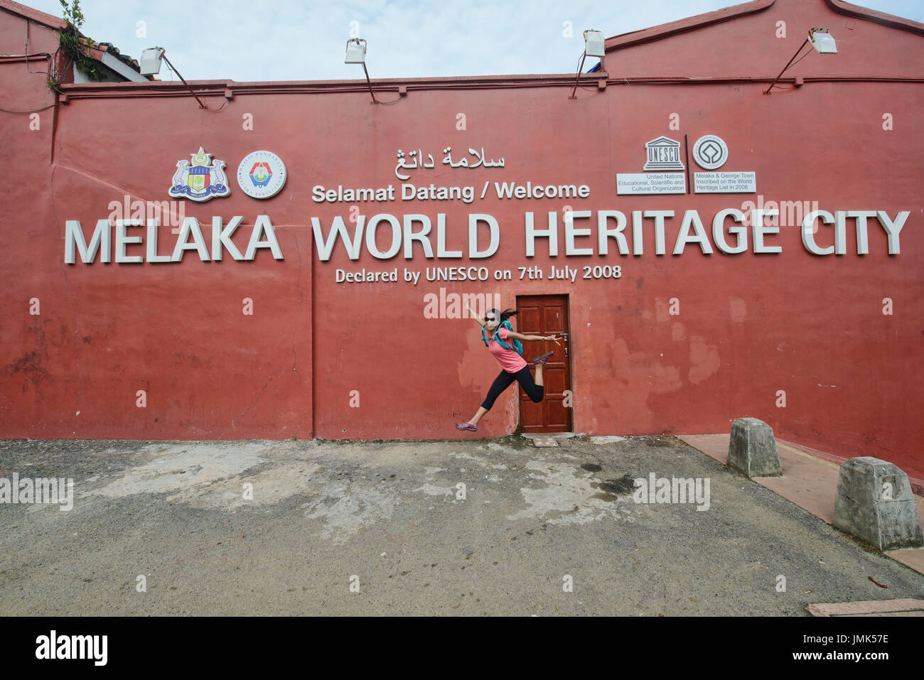 Jumpshot of a tourist at Unesco World Heritage, Malacca, Malaysia - Stock Image