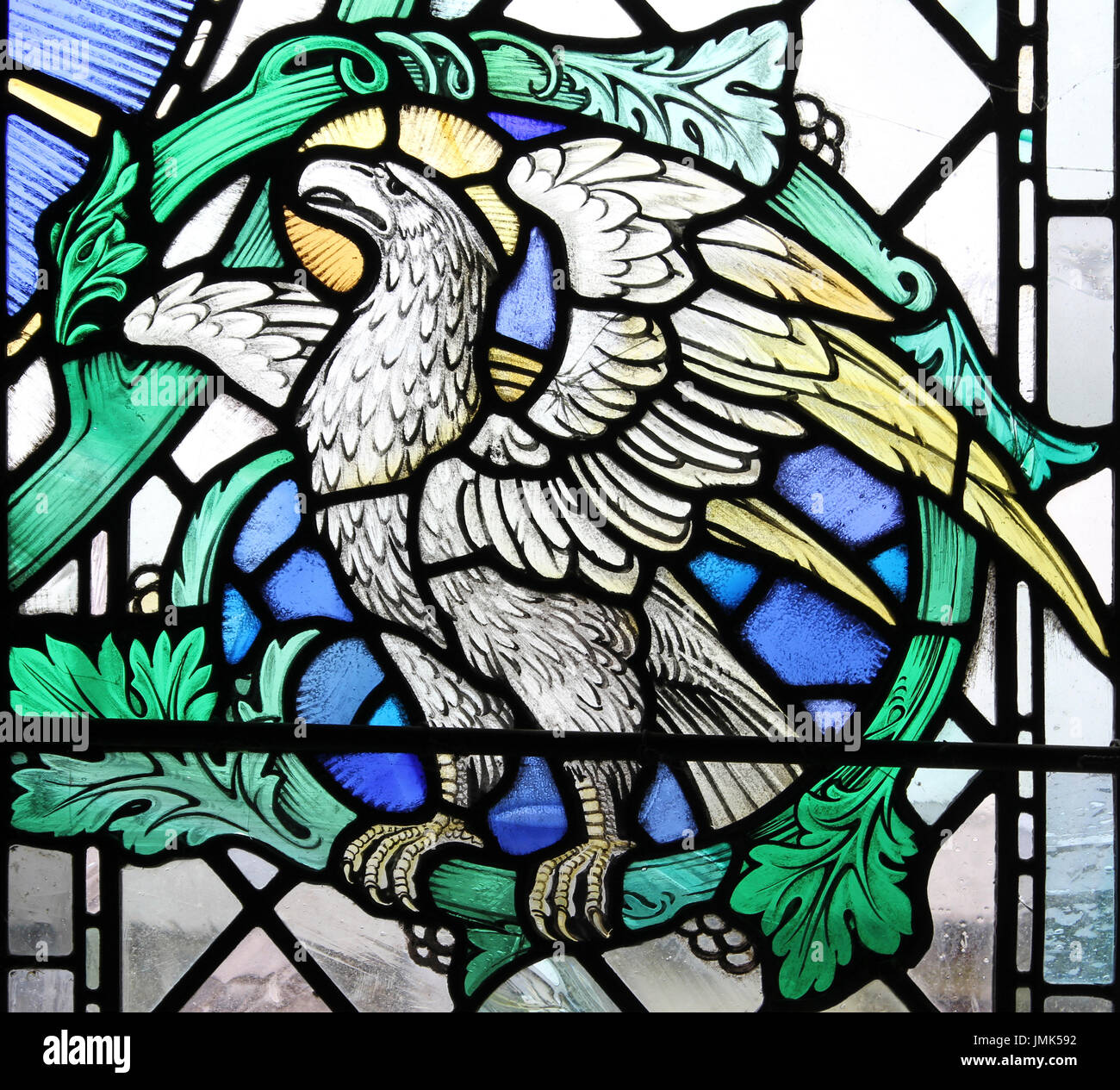 Stained Glass Window depicting an Eagle - one of the four Apocalyptic beasts - this symbolizing John the Evangelist - Stock Image