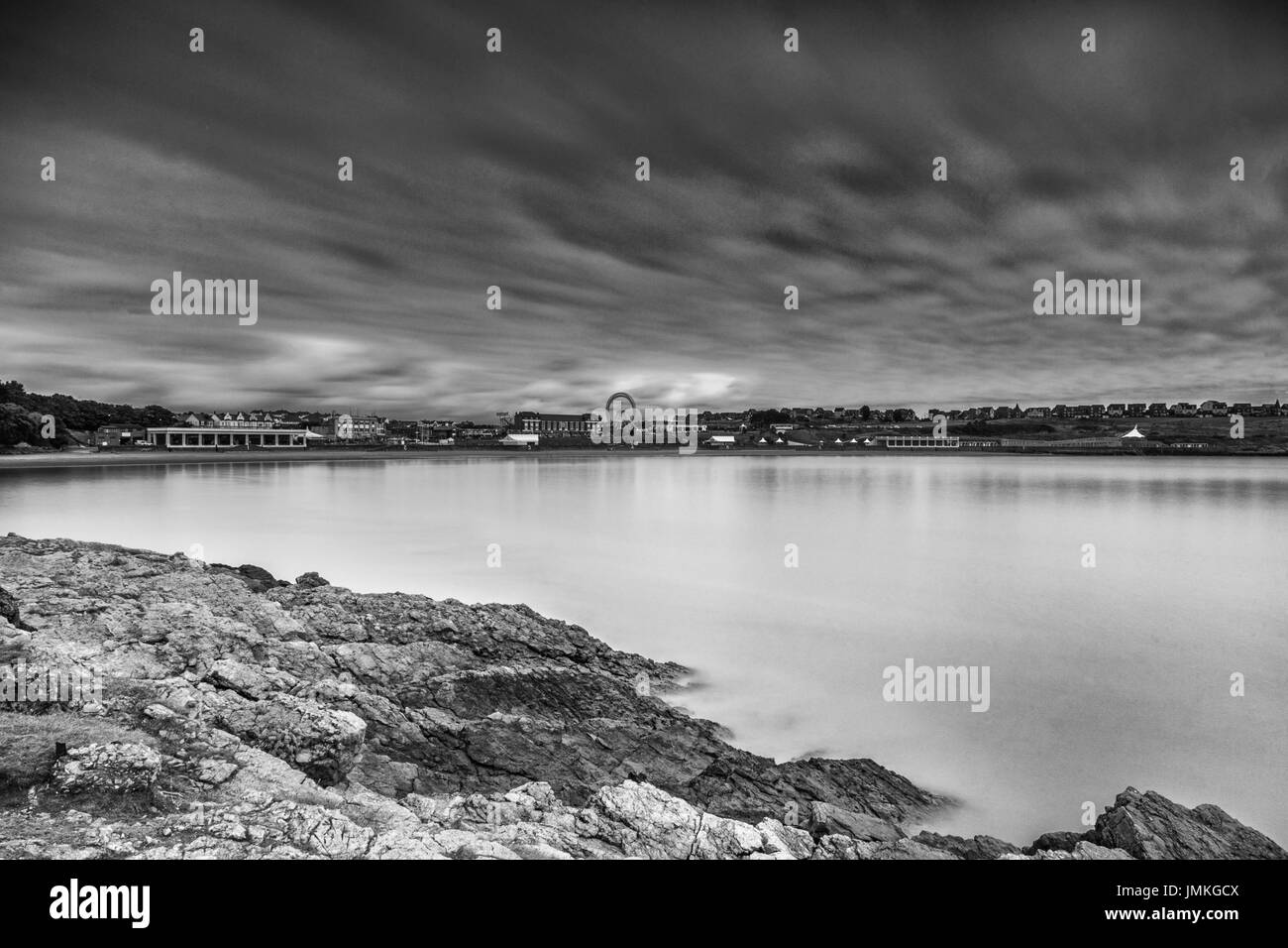 A two minute exposure over Whitmore Bay, Barry Island, Barry in Wales, United Kingdom. Stock Photo